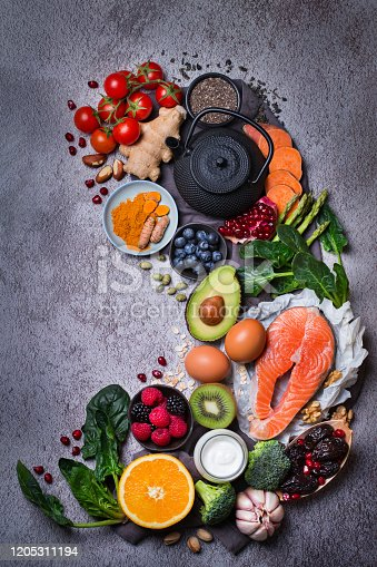 854725402 istock photo Assortment of healthy food, superfood ingredients for cooking on table 1205311194