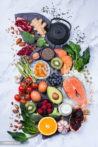 854725402 istock photo Assortment of healthy food, superfood ingredients for cooking on table 1205311220
