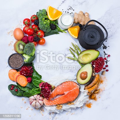 854725402 istock photo Assortment of healthy food, superfood ingredients for cooking on table 1205311230