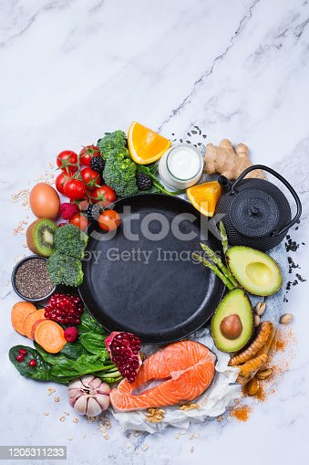 854725402 istock photo Assortment of healthy food, superfood ingredients for cooking on table 1205311233