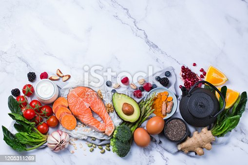 854725402 istock photo Assortment of healthy food, superfood ingredients for cooking on table 1205311269