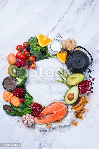 854725402 istock photo Assortment of healthy food, superfood ingredients for cooking on table 1205311674