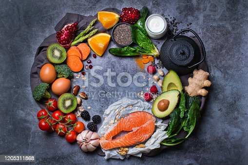 854725402 istock photo Assortment of healthy food, superfood ingredients for cooking on table 1205311868