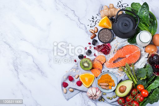 854725402 istock photo Assortment of healthy food, superfood ingredients for cooking on table 1205311930
