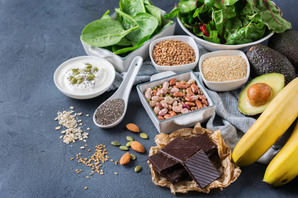 assortment of healthy high magnesium sources food - magnesium stock photos and pictures