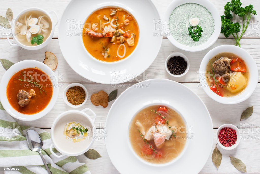 Assortment of hot soups flat lay stock photo