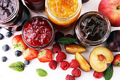 istock assortment of jams, seasonal berries, plums, mint and fruits 898479192