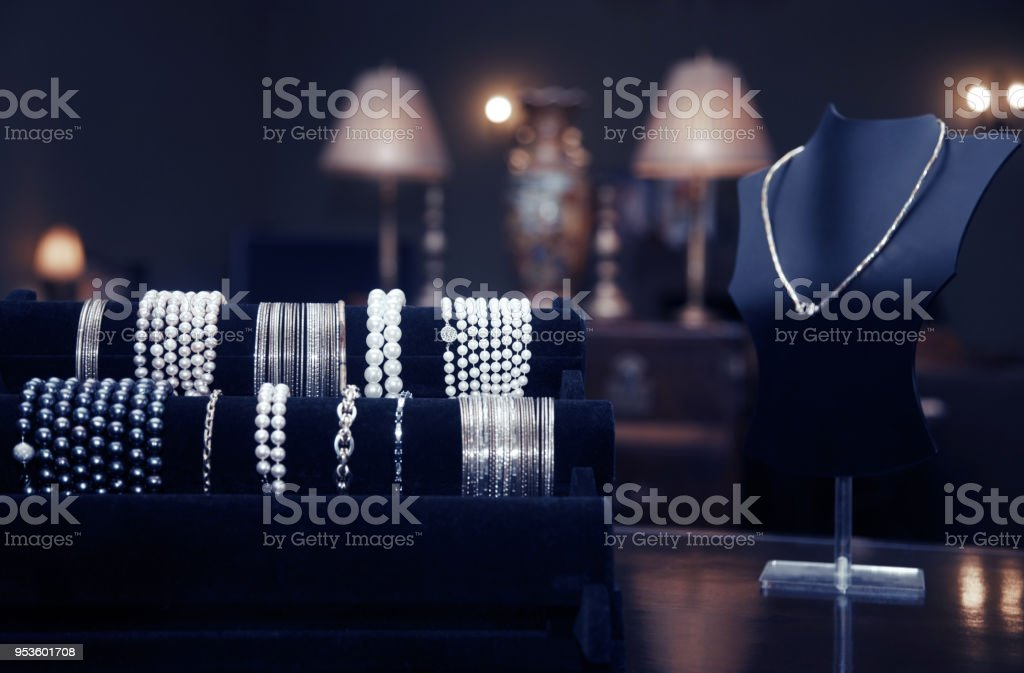 Assortment of jewelry in a jewelry shop. Close-up view stock photo