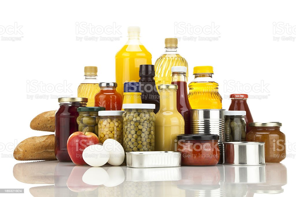 Assortment of large group of canned food against white background stock photo