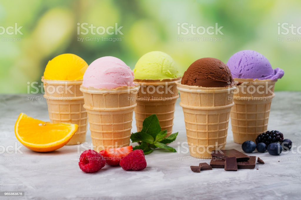 Assortment of natural ice cream - strawberry, chocolate, orange, blueberry and mint royalty-free stock photo