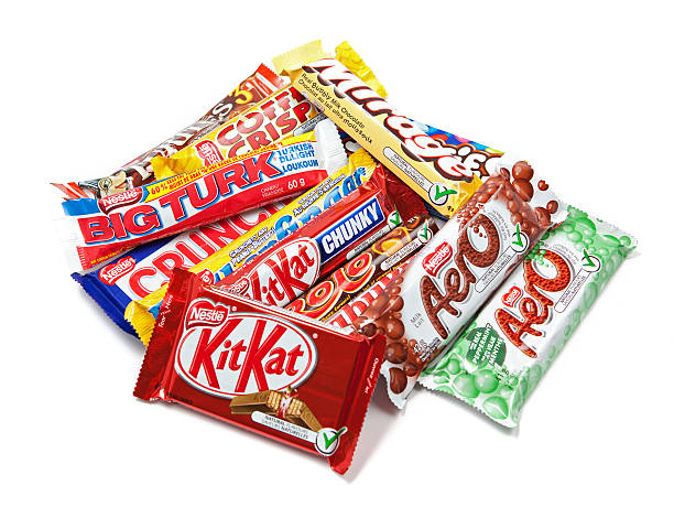assortment of nestle chocolate products - kit kat stock photos and pictures