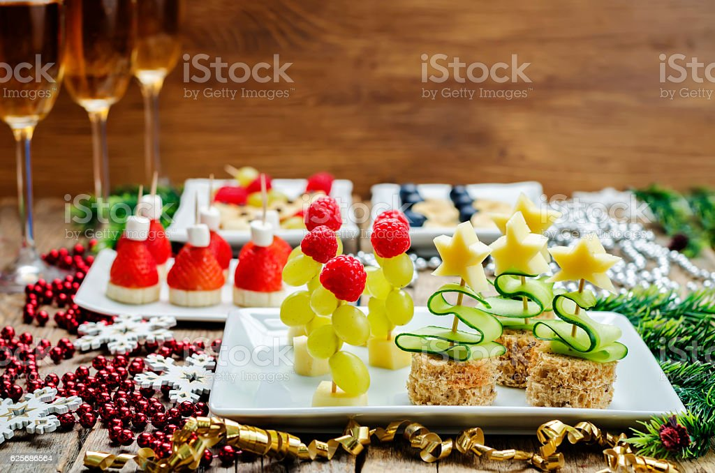 Assortment of New Year's snacks and a glass of champagne stock photo