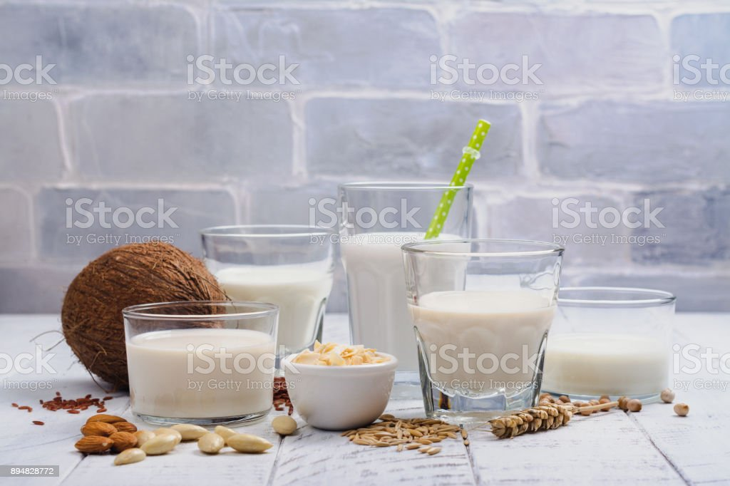 Assortment of non dairy vegan milk and ingredients stock photo