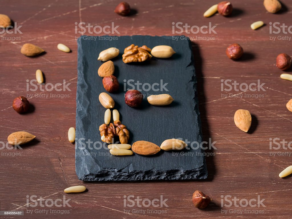 Assortment of nuts and vitamin E concept stock photo