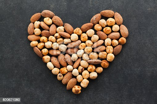 istock Assortment of nuts in a heart shape. 820621080