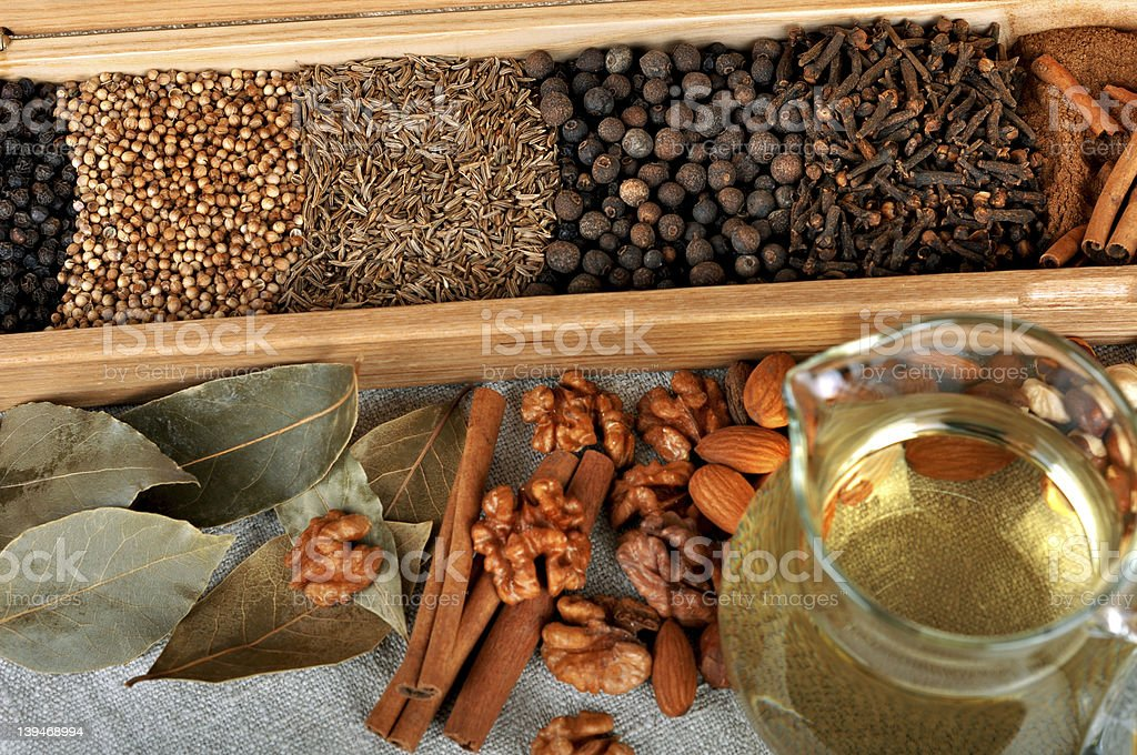 Assortment of peppercorns and chili in wooden box royalty-free stock photo