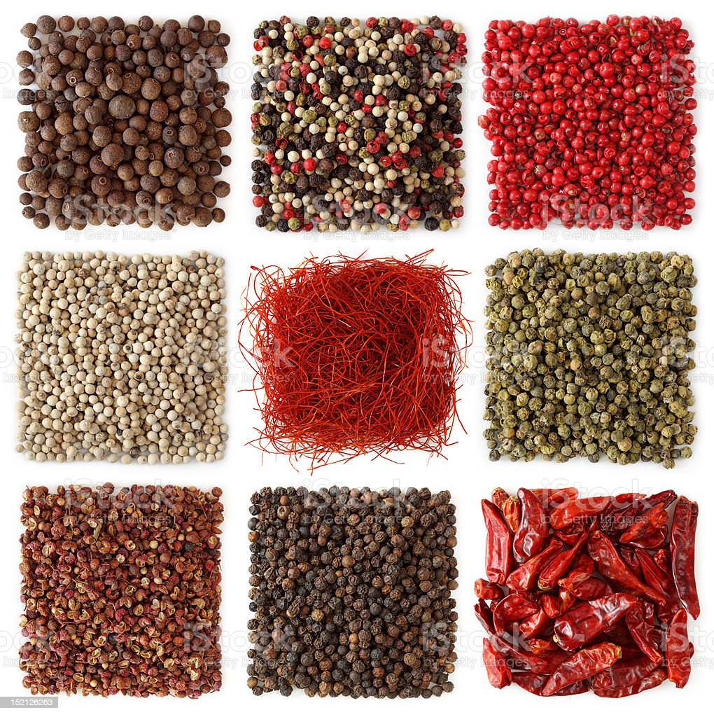 Assortment of peppercorns and chili stock photo