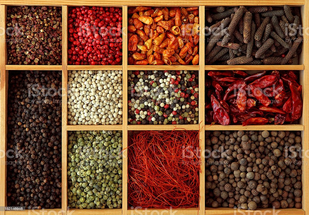 Assortment of peppercorns and chili royalty-free stock photo