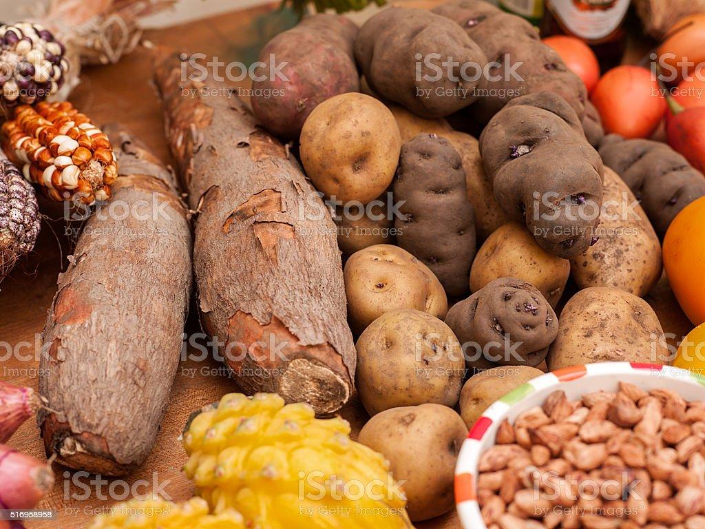 Assortment of Peruvian potatoes, corn, and yucca stock photo
