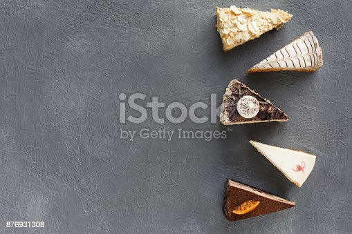 istock Assortment of pieces of cake, copy space 876931308