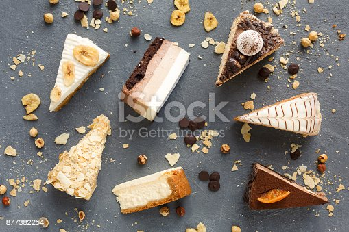 istock Assortment of pieces of cake, copy space 877382254