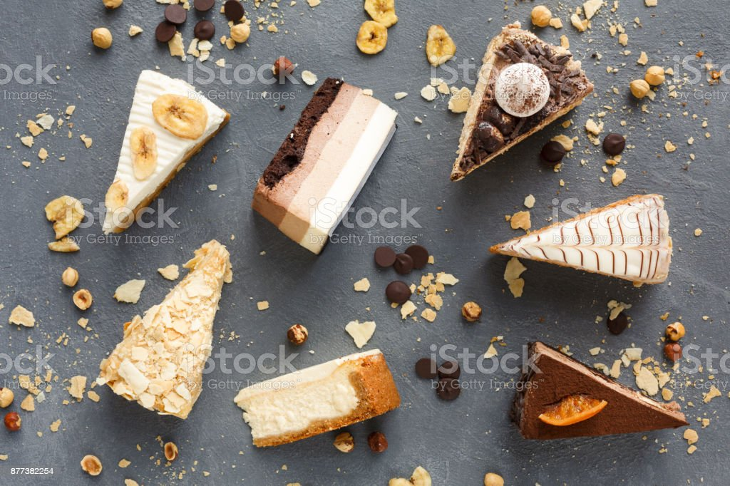 Assortment of pieces of cake, copy space stock photo