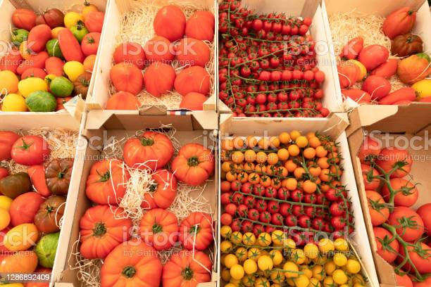 Assortment Of Red And Yellow Tomatoes On A Market Stall Stock Photo - Download Image Now