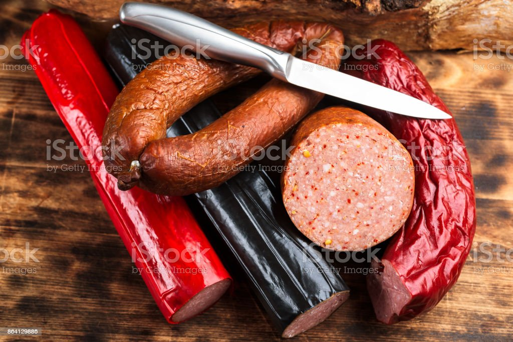 Assortment of sausages and knife royalty-free stock photo