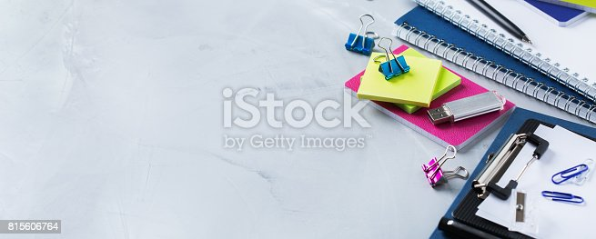 istock Assortment of school business supplies, crayons, pens 815606764