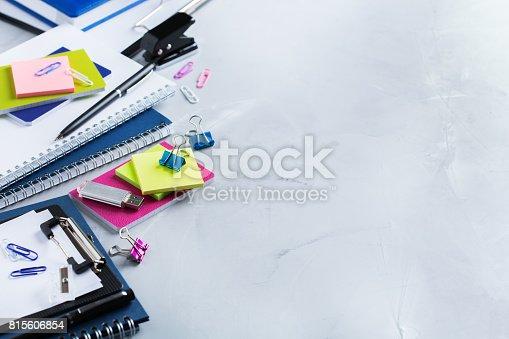 istock Assortment of school business supplies, crayons, pens 815606854