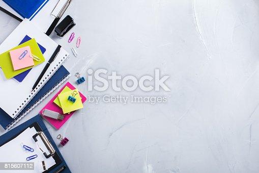 istock Assortment of school business supplies, crayons, pens 815607112