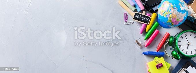 istock Assortment of school business supplies, crayons, pens 815607446