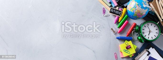 istock Assortment of school business supplies, crayons, pens 815609540