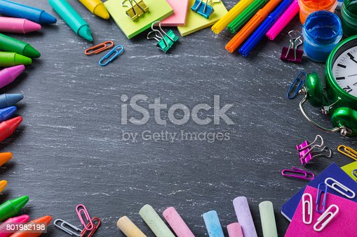 istock Assortment of school supplies, crayons, pens, chalks 801982198