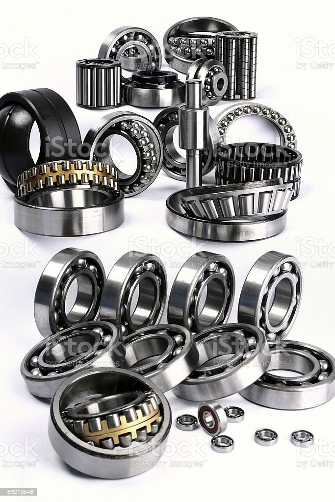 Assortment of shiny metallic bearings on a white background royalty-free stock photo