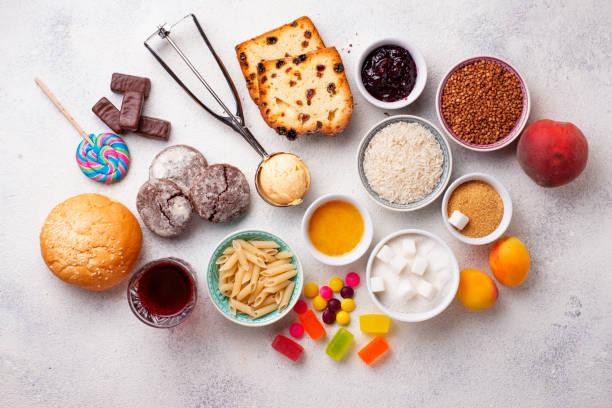surtido de alimentos simples de carbohidratos - carbohidrato fotografías e imágenes de stock