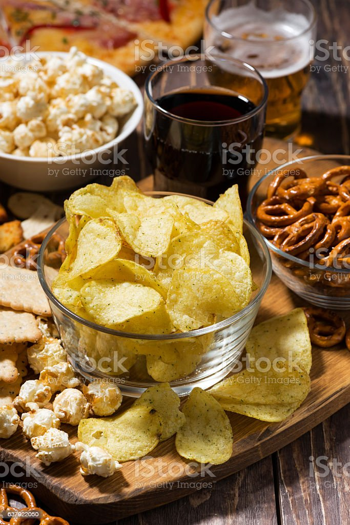 assortment of snacks for beer, fast food, vertical stock photo