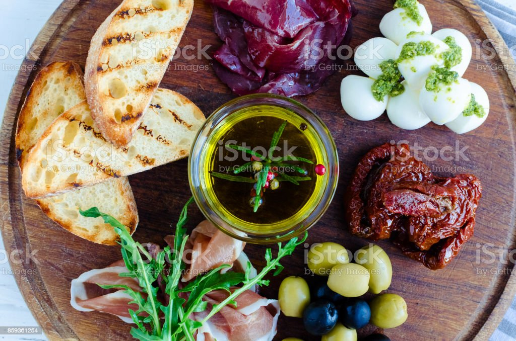 Assortment of spanish tapas or italian antipasti stock photo