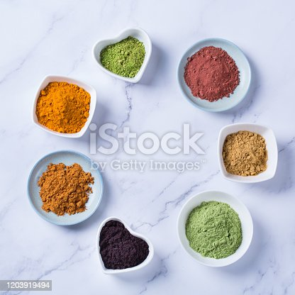 1005962360 istock photo Assortment of superfood powder, acai, turmeric, ginger, matcha, cinnamon, wheat 1203919494