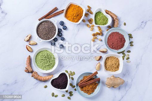 1005962360 istock photo Assortment of superfood powder, acai, turmeric, ginger, matcha, cinnamon, wheat 1203919504