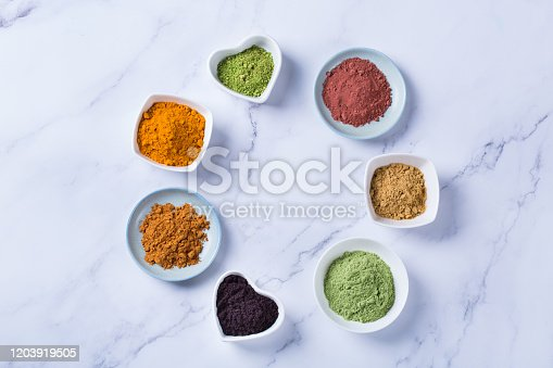 1005962360 istock photo Assortment of superfood powder, acai, turmeric, ginger, matcha, cinnamon, wheat 1203919505