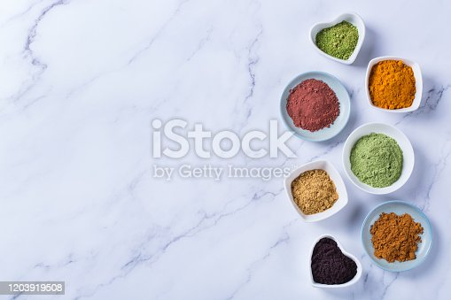 1005962360 istock photo Assortment of superfood powder, acai, turmeric, ginger, matcha, cinnamon, wheat 1203919508