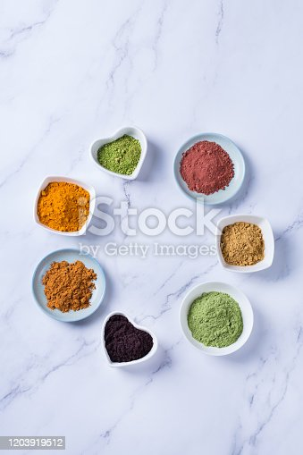 1005962360 istock photo Assortment of superfood powder, acai, turmeric, ginger, matcha, cinnamon, wheat 1203919512