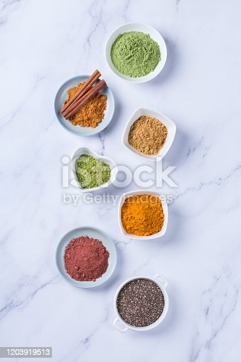 1005962360 istock photo Assortment of superfood powder, acai, turmeric, ginger, matcha, cinnamon, wheat 1203919513