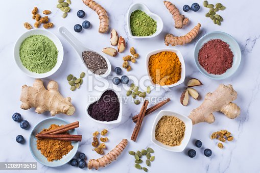 1005962360 istock photo Assortment of superfood powder, acai, turmeric, ginger, matcha, cinnamon, wheat 1203919515