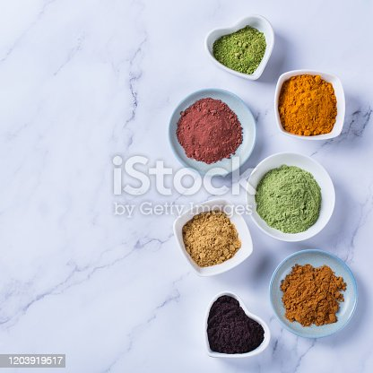 1005962360 istock photo Assortment of superfood powder, acai, turmeric, ginger, matcha, cinnamon, wheat 1203919517