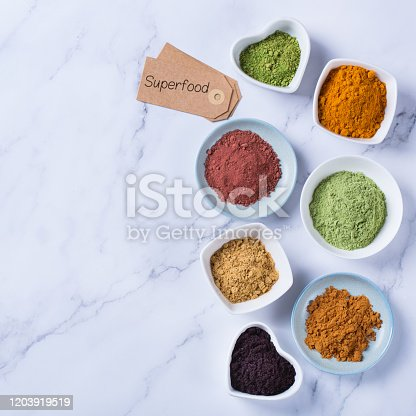 1005962360 istock photo Assortment of superfood powder, acai, turmeric, ginger, matcha, cinnamon, wheat 1203919519