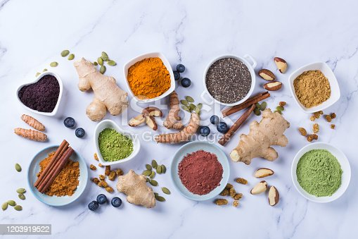 1005962360 istock photo Assortment of superfood powder, acai, turmeric, ginger, matcha, cinnamon, wheat 1203919522