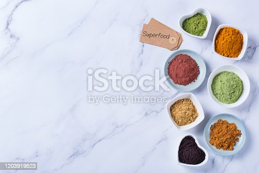 1005962360 istock photo Assortment of superfood powder, acai, turmeric, ginger, matcha, cinnamon, wheat 1203919523