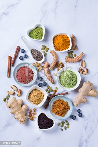 1005962360 istock photo Assortment of superfood powder, acai, turmeric, ginger, matcha, cinnamon, wheat 1203919527